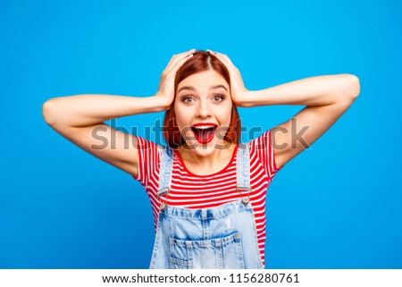 It's cool wow sale discount seasonal concept. Close up studio photo portrait of pretty cute funny with open mouth girl staring in camera touching head with hands isolated bright vivid shine background