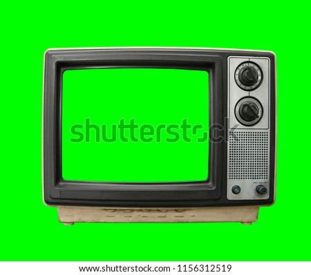 Very dirty vintage television with chroma green background and screen.