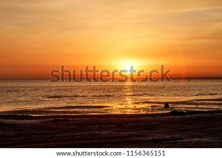 Beautiful sunset over the sea. The sun sets on the water. The sky is painted with bright colors. Summer evening. Sunset beach.  Gulf of Finland, Baltic sea, Sestroretsk, Saint-Petersburg, Russia   #1156365151
