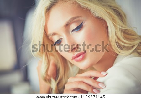Beautiful young woman portrait ,sitting in office #1156371145