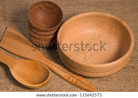 Wooden bowls and spoons on burlap #115642573