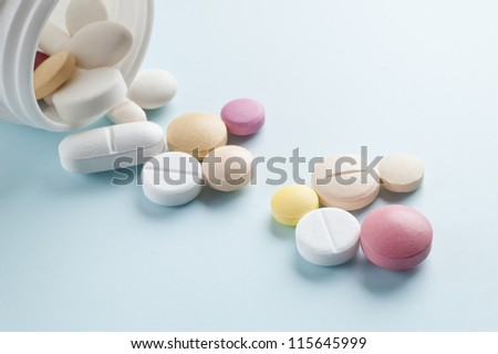 Tablets with capsules. Royalty-Free Stock Photo #115645999