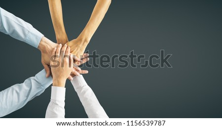 Hands put together on black background with copy space. Union, togetherness and teamwork concept  #1156539787