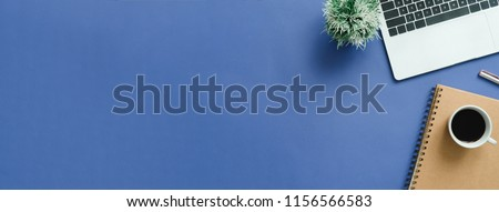 Minimal work space - Creative flat lay photo of workspace desk. Top view office desk with laptop, notebooks and coffee cup on blue color background. Panoramic banner background with copy space.  #1156566583