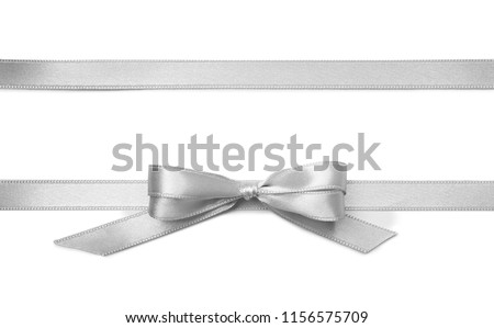 Silver ribbons with bow on white background Royalty-Free Stock Photo #1156575709
