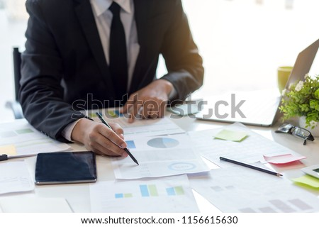 Businessman sitting analyze document information in the workplace. Royalty-Free Stock Photo #1156615630