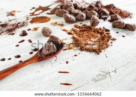 Chocolate chips and chocolate powder #1156664062