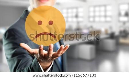 businessman is selecting a sad mood emoticon #1156677103