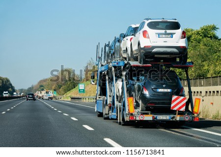 Rome, Italy - October 4, 2017: New car carrier in the road. Truck transporter #1156713841
