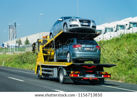 Rome, Italy - October 4, 2017: Cars carrier on the road. Truck transporter #1156713850