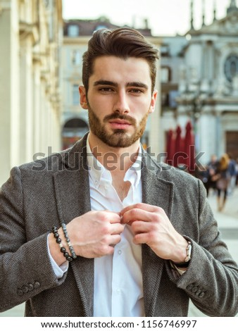 Handsome serious businessman standing outside in elegant European city center, Turin in Italy #1156746997