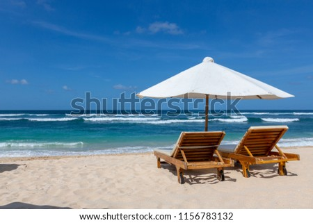 Place for beach holidays with umbrellas at  Bali island  #1156783132
