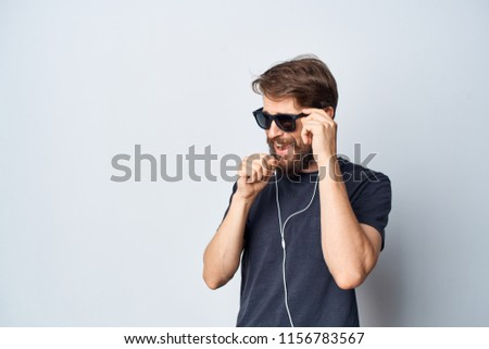 a man with glasses in his headphones looks aside                           #1156783567