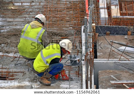 Besançon, France - January 15, 2014: Workers on a construction site. #1156962061