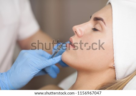 Beauty injections Close Up. Lip filler injection. #1156967047