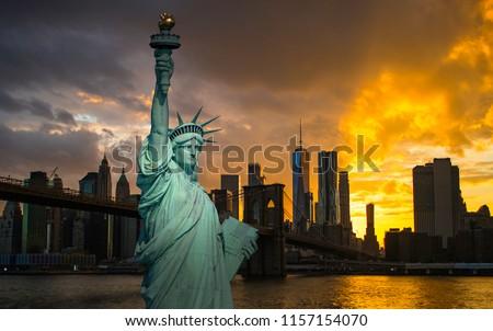 New York City Manhattan downtown skyline and Brooklyn bridge at sunset #1157154070