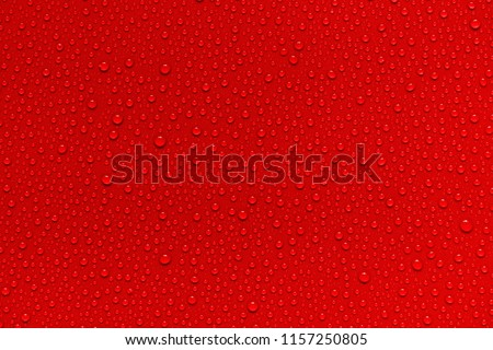 Water drops on red background.