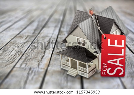 Classic house model on sale on backgrouund Royalty-Free Stock Photo #1157345959