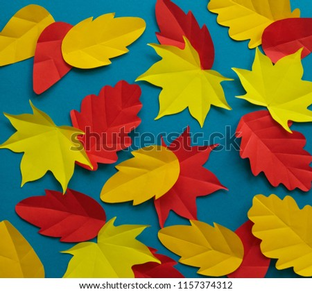Leaves of paper fall red, orange, yellow leaf fall. Blue background. Handmade origami. #1157374312