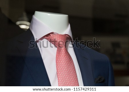 Social clothing suit and outrageous necktie being sold in the shop window Idioma de palabras clave: English #1157429311