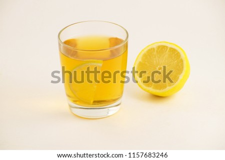Cup of hot tea with lemon slice on a white background. Glass of ice tea with lemon. Healthy lifestyle. #1157683246