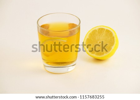 Cup of hot tea with lemon slice on a white background. Glass of ice tea with lemon. Healthy lifestyle. #1157683255