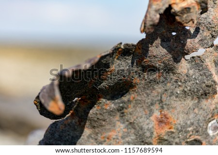 rusty leftover from an old steel construction at the sea #1157689594