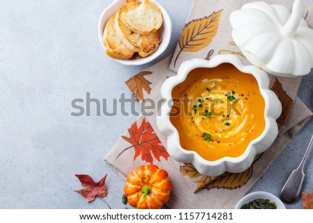Pumpkin soup in bowl on grey stone background. Copy space. Top view. #1157714281