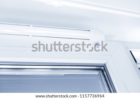 Double glazed window with ventilation unit. Closeup. Nobody. Blue tone #1157736964