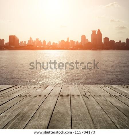 wooden platform before modern city #115784173