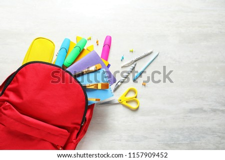 Flat lay composition with backpack, school stationery and space for text on light background #1157909452