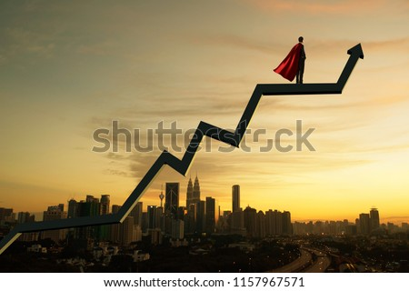 Businessman in suit and cape hero and charts with sunrise city skyline background . Financial economic growth concept #1157967571