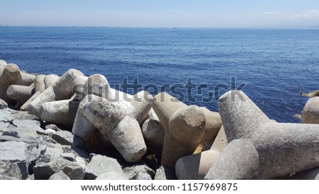 a sea scene with breakwater #1157969875