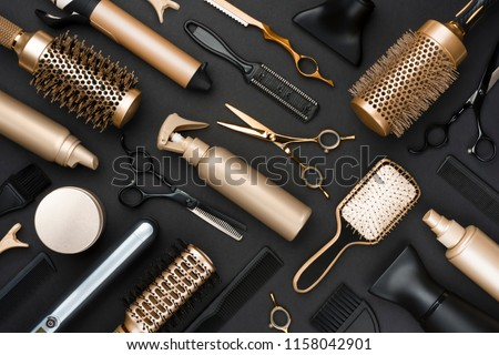 Full frame of professional hair dresser tools on black background Royalty-Free Stock Photo #1158042901