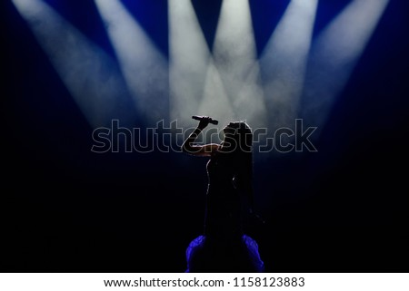 Singer in silhouette Royalty-Free Stock Photo #1158123883