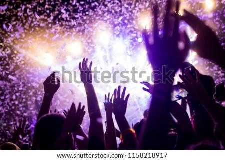 Portrait of happy crowd enjoying at music festival #1158218917