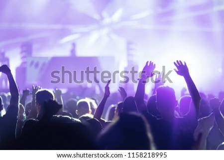 Picture of dancing crowd at music festival #1158218995