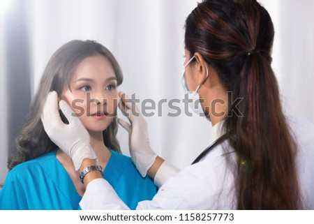 Asian Patient was checked health by india middle east Doctor woman in uniform with stethoscope, rubber gloves in Medical hospital clinic, concept rhinoplastry check before plastic surgery, copy space #1158257773