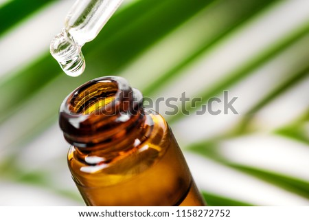 herbal essence. alternative medicine. essential oil dropping from pipette to the bottle #1158272752