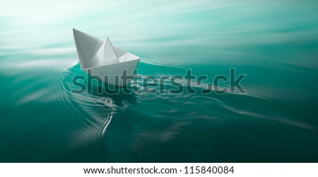 origami paper boat sailing on water causing waves and ripples #115840084