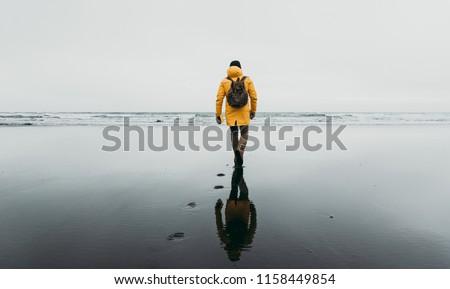 Wanderlust explorer discovering icelandic natural wonders #1158449854