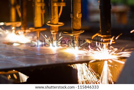 CNC LPG cutting with sparks close up Royalty-Free Stock Photo #115846333