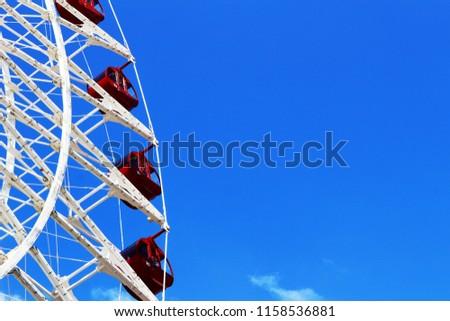 A large Ferris wheel built under the blue sky #1158536881