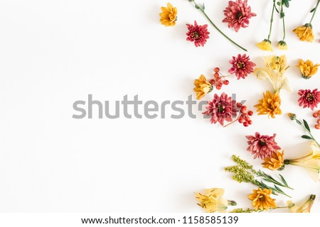 Autumn floral composition. Frame made of fresh flowers on white background. Autumn, fall concept. Flat lay, top view, copy space #1158585139