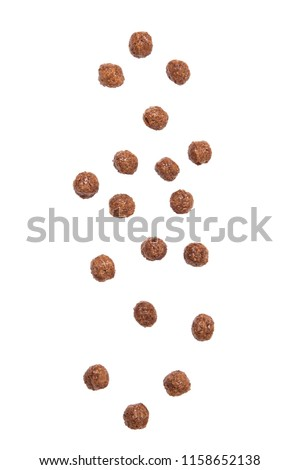 Chocolate cereal balls falling isolated on white background. Royalty-Free Stock Photo #1158652138