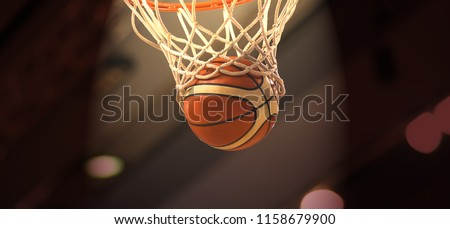 The orange basketball ball flies through the basket #1158679900