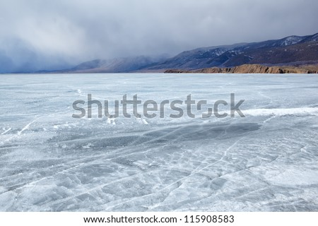 outdoor view of frozen baikal lake in winter Royalty-Free Stock Photo #115908583