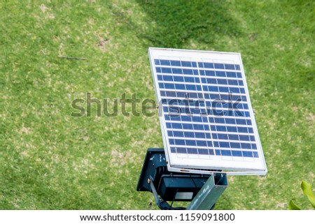 Soft light to solar cell panel street light above walk way side with blurred green grass background in countryside thailand.Green energy Concept.Selective focus. #1159091800