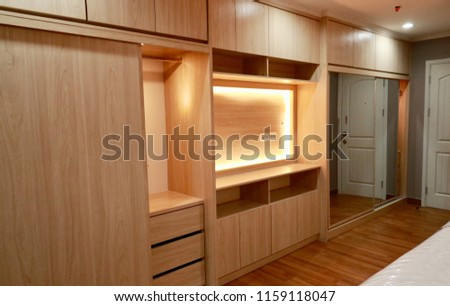 comfortable and luxury interior wooden closet with warm white led: Built in room: life style #1159118047