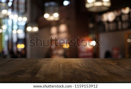 Empty dark wooden table in front of abstract blurred bokeh background of restaurant . can be used for display or montage your products.Mock up for space #1159153912